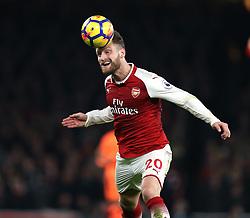 22 December 2017 London : Premier League Football : Arsenal v Liverpool : Shkodran Mustafi of Arsenal heads the ball.<br /> (photo by Mark Leech)