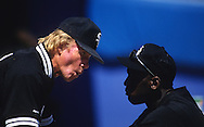 SARASOTA, FL-MARCH 1994:  NBA Hall of Famer Michael Jordan talks with Chicago White Sox hitting coach Walt Hriniak during spring training in Sarasota, Florida in March 1994.  (Photo by Ron Vesely)