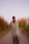Vertical soft focus of man strolling in autumn<br />