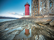 The Little Red Lighthouse (Jeffrey's Hook Light) is a small lighthouse located under the George Washington Bridge in Fort Washington Park on the Hudson River in Manhattan, New York City