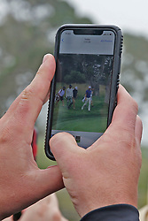 June 12, 2019 - Pebble Beach, CA, U.S. - PEBBLE BEACH, CA - JUNE 12: A fan takes a photo of Tiger Woods with his cell phone on the 16th hole during a practice round for the 2019 US Open on June 12, 2019, at Pebble Beach Golf Links in Pebble Beach, CA. (Photo by Brian Spurlock/Icon Sportswire) (Credit Image: © Brian Spurlock/Icon SMI via ZUMA Press)
