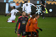 Jordan Ayew of Swansea city (18) celebrates after he beats and goes past several Wolverhampton Wanderers players to score his teams 1st goal, with many people comparing his solo run and goal to a Ricky Villa FA cup goal of the past. The Emirates FA Cup, 3rd round replay match, Swansea city v Wolverhampton Wanderers at the Liberty Stadium in Swansea, South Wales on Wednesday 17th January 2018.<br /> pic by  Andrew Orchard, Andrew Orchard sports photography.