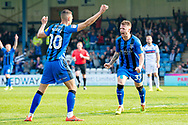 Gillingham FC midfielder Mark Byrne (33) scores a goal (1-1) and celebrates with team mates during the EFL Sky Bet League 1 match between Gillingham and Rochdale at the MEMS Priestfield Stadium, Gillingham, England on 30 March 2019.