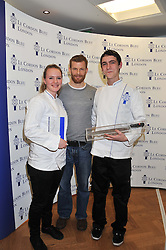 Left to right, ABIGAIL WATSON winner of the Cordon Bleu scholarship, chef TOM AIKENS and LLOYD PINDER winner of the Cordon Bleu scholarship at the Grand Opening of Le Cordon Bleu's International Flagship School at 15 Bloomsbury Square, London WC1 on 7th February 2012.