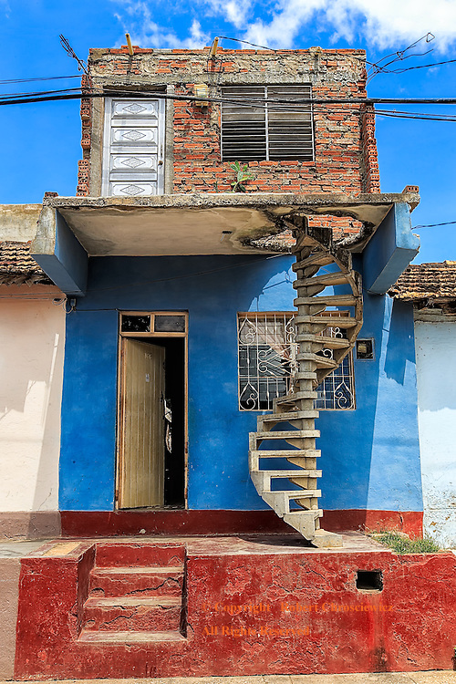 Architectural Horror Show: A strange mixture of construction materials and styles make this residential home an architectural horror show that is as dangerous as it looks, Trinidad Cuba.