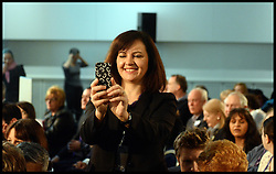 Caroline Flint takes a  picture  at the Labour Party Special Conference being held at the Excel Centre. London, United Kingdom. Saturday, 1st March 2014. Picture by Andrew Parsons / i-Images
