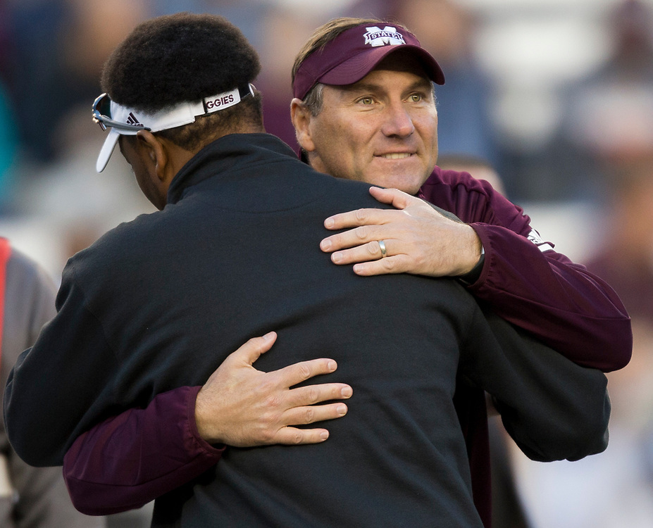 Mississippi State head coach Dan Mullen, hugs Texas A&M head coach Kevin Sumlin at midfield before the start of a NCAA college football game on Saturday, Oct. 28, 2017, in College Station, Texas. (AP Photo/Sam Craft)