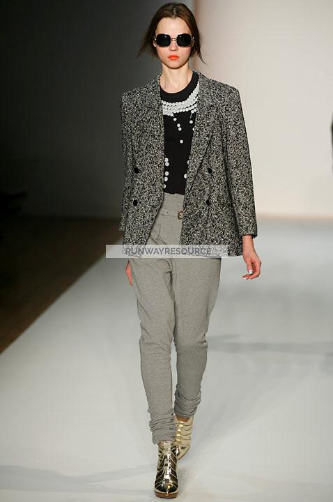 Egle Tvirbutaite walks the runway wearing Karen Walker Fall 2009 Collection