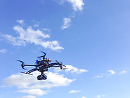 A large octocopter drone with eight motors made by Aeronavics carrying a Lumix G4 camera.