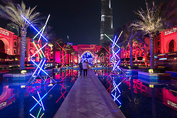Mikado light sculpture by Edouard Levine illuminating Souk al Bahar at opening night of the inaugural Dubai Festival of Lights held in Downtown Dubai 2014