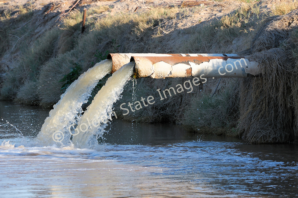 Untreated farm irrigation runoff containing pesticides and fertilizers flows directly into an already highly polluted New River.