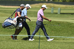 June 21, 2018 - Cromwell, CT, USA - Jason Day, right, and Daniel Berger, center, walk up the fifth fairway during the first round of the Travelers Championship on Thursday, June 21, 2018 at TPC River Highlands in Cromwell, Conn. (Credit Image: © John Woike/TNS via ZUMA Wire)