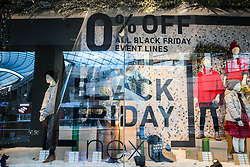 © Licensed to London News Pictures. 24/11/2017. Leeds, UK. Picture shows a next shop window with 0% off in the Trinity shopping centre in Leeds this morning on Black Friday. Photo credit: Andrew McCaren/LNP