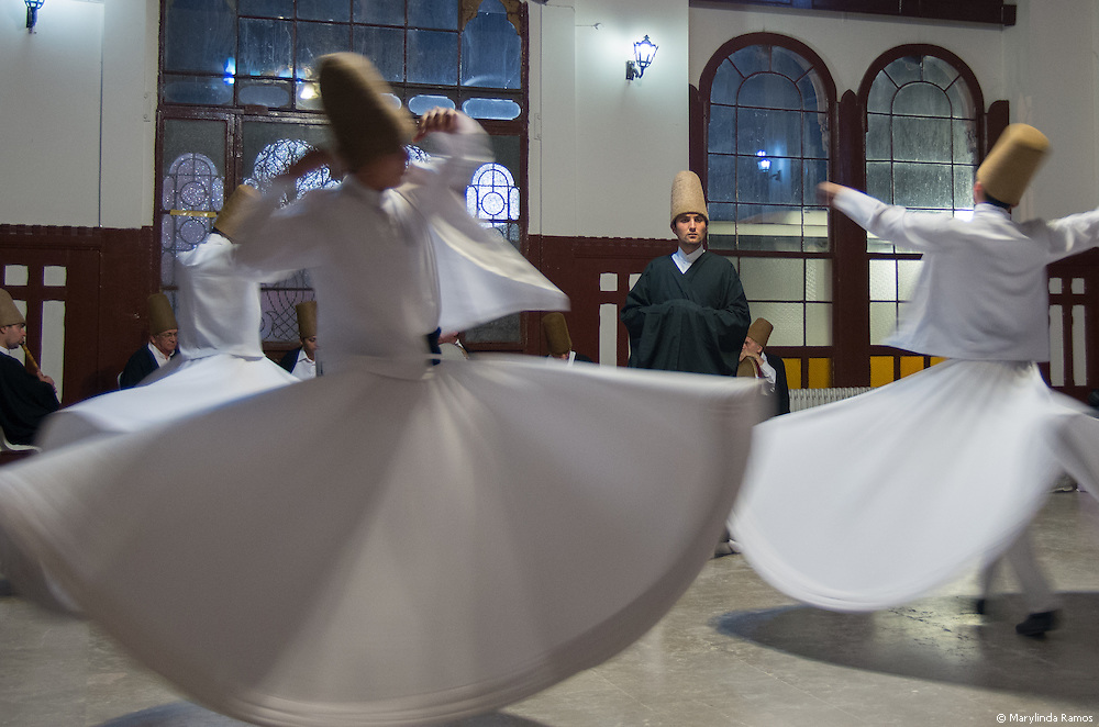 At Sirkeci Station in Eminonu, visitors are invited to witness the whirling dervish ceremoy.  Music sets the stage for worship.  The dervishes then enter the room in a procession, and bow head to ground before removing their black cloaks in preparation fo rhte trance.  As they whirl, one hand faces earth and the other heaven.