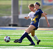 OFallon midfielder Josie Nieroda (front) wins the ball from Edwardsville midfielder Campbell Slemmer. OFallon defeated Edwardsville in a girls soccer playoff game at OFallon High School in OFallon, IL on Tuesday June 8, 2021. <br /> Tim Vizer/Special to STLhighschoolsports.com.