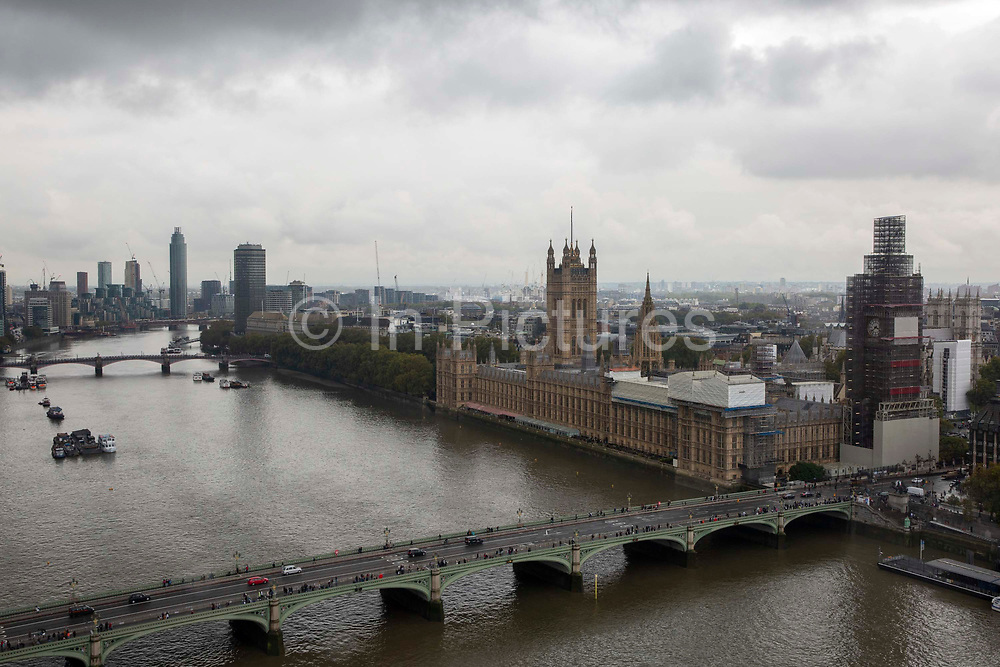 An aerial view of the The Palace of Westminster, also known as the Houses of Parliament or Westminster Palace covered in scaffolding.  It is the meeting place of the two houses of the Parliament of the United Kingdom and is on the bank of the river Thames in London.