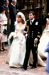 File photo dated 23/07/1986 of Prince Andrew and his bride Sarah Ferguson in Westminster Abbey, London during their wedding ceremony as a worldwide television of 500 million tuned in to watch them say their marriage vows in a lavish ceremony.