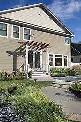 VA1-966-326 322 Owaissa home rear entrance with pergola and large stone pathway