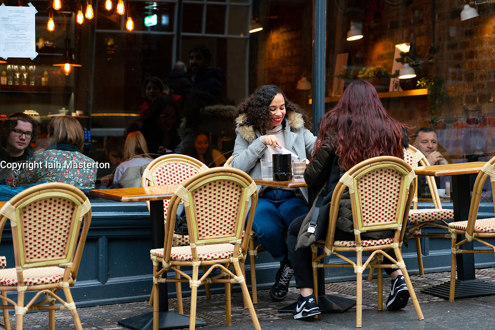 Edinburgh, Scotland, UK. 14 November 2020. Views of Edinburgh city centre on Saturday afternoon during a level 3 lockdown imposed by the Scottish Government;.Pictured;  Scran restaurant on Cockburn Street is now open. Iain Masterton/Alamy Live News.