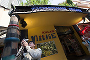 """The Hundertwasserhaus, the first and most famous public housing project by Austrian artist and architekt Friedensreich Hundertwasser. Mr. Kalke's """"Hundertwasser Village"""" across the street is one of many souvenir shops in and around the house."""