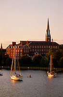 """Annapolis, Maryland-- a boater amkes his way from the water on Spa Creek behind St. Mary's Catholic Church. St Mary'sChurch,in the Historic District of Annapolis was built on the property of Revolutionary patriotCharles Carroll of Carrollton, the only Catholic signer of the Declaration of Independence. The church was concencrated in 1860. Annapolis is known as the """"Sailing Capital of the World."""""""