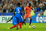 Netherlands' forward Quincy Promes runs with the ball during the FIFA World Cup Russia 2018, Qualifying Group A football match between France and Netherlands on August 31, 2017 at the Stade de France in Saint-Denis, north of Paris, France - Photo Benjamin Cremel / ProSportsImages / DPPI