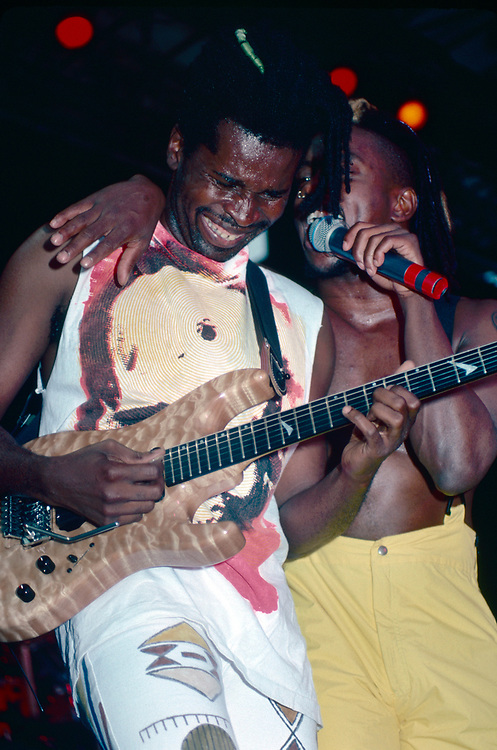 STANHOPE - AUGUST 14: (L-R) Guitarist Vernon Reid and singer Corey Glover of Living Colour perform during Lollapalooza at Waterloo Village on August 14, 1991 in Stanhope, New Jersey. (Photo by Lisa Lake)