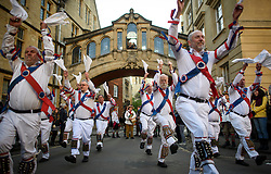 """© Licensed to London News Pictures. 01/05/2018. Oxford, UK. Morris dancers in dress dance underneath Hertford Bridge, often called """"the Bridge of Sighs""""  in Oxford, Oxfordshire as part of May Day celebrations. Students were again prevented from jumping from Magdalen Bridge in to the river, which has historically been a tradition, due to injuries at a previous years event . Photo credit: Ben Cawthra/LNP"""