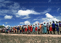 Women queue to vote in Matabeland in the 1980 general election in Zimbabwe after gaining it's independance. February 1980. Photographed by Terry Fincher