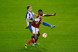 Bristol City Midfielder Jay Emmanuel-Thomas (ENG) is challenged by Bristol Rovers Defender Mark McChrystal (NIR) during the second half of the match - Photo mandatory by-line: Rogan Thomson/JMP - Tel: 07966 386802 - 04/09/2013 - SPORT - FOOTBALL - Ashton Gate, Bristol - Bristol City v Bristol Rovers - Johnstone's Paint Trophy - First Round - Bristol Derby