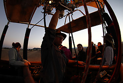 NAMIBIA SOSSUSVLEI 21APR14 - Pilot Eric Hesemans launches his balloon during a flight with Namib Sky Balloon Safaris in Sossusvlei, Namib Desert, Namibia.<br /> <br /> jre/Photo by Jiri Rezac<br /> <br /> © Jiri Rezac 2014