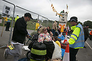 12 local activists locked themselves in specially made arm tubes to block the entrance to Quadrillas drill site in New Preston Road, July 03 2017, Lancashire, United Kingdom. First police arrives, early morning. The 13 activists included 3 councillors; Julie Brickles, Miranda Cox and Gina Dowding and Nick Danby, Martin Porter, Jeanette Porter,  Michelle Martin, Louise Robinson,<br /> Alana McCullough, Nick Sheldrick, Cath Robinson, Barbara Cookson, Dan Huxley-Blyth. The blockade is a repsonse to the emmidiate drilling for shale gas, fracking, by the fracking company Quadrilla. Lancashire voted against permitting fracking but was over ruled by the conservative central Government. All the activists have been active in the struggle against fracking for years but this is their first direct action of peacefull protesting. Fracking is a highly contested way of extracting gas, it is risky to extract and damaging to the environment and is banned in parts of Europe . Lancashire has in the past experienced earth quakes blamed on fracking.