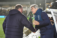 West Ham United manager Manuel Pellegrini and Wimbledon Manager Wally Downes during the The FA Cup fourth round match between AFC Wimbledon and West Ham United at the Cherry Red Records Stadium, Kingston, England on 26 January 2019.