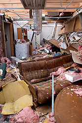 25 Sept, 2005.  Cameron, Louisiana. Hurricane Rita aftermath. <br /> Inside a residence alongside the canal, smashed by the storm.<br /> Photo; ©Charlie Varley/varleypix.com