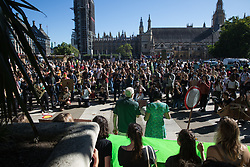 London, UK. 24th September, 2021. Jeremy Corbyn, former Labour Party leader, addresses hundreds of young people in Parliament Square taking part in a Global Climate Strike to demand intersectional climate justice. The Global Climate Strike was organised to highlight the detrimental influences through colonialism, imperialism and exploitation of the Global North on MAPA (Most Affected Peoples and Areas), which have contributed to them now experiencing the worst impacts of the climate crisis, and to call on the Global North to pay reparations to MAPA.