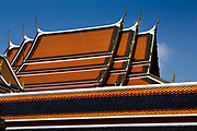 Coloured ceramic  tiles on the chedi roofs of Wat Pho temple, Bangkok. Wat Pho is one of the largest and oldest wats in Bangkok (with an area of 50 rai, 80,000 square metres), and is home to more than one thousand Buddha images, as well as one of the largest single Buddha images of 160 ft length: the Reclining Buddha .