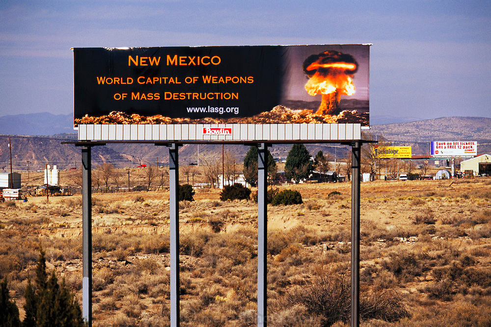 "Nuclear weapons billboard on I-25. Santa Fe, New Mexico. The signs reads ""New Mexico, World Capital of Weapons of Mass Destruction. USA. www.lasg.org."""