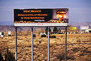 """Nuclear weapons billboard on I-25. Santa Fe, New Mexico. The signs reads """"New Mexico, World Capital of Weapons of Mass Destruction. USA. www.lasg.org."""""""