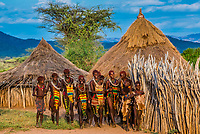 A group of Hamer tribe women walking through their village, Omo Valley, Ethiopia.