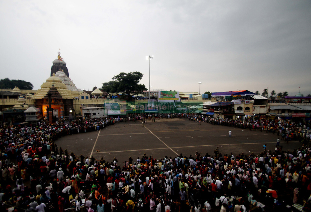June 24, 2017 - Bhubaneswar, Odisha, India - Devotees gathered in front of the Shree Jagannath temple as they arrives to participate ditties annual rath yatra festival or chariot festival as temple servitors busy to decorate wooden chariots and temple at Puri, 65 km away from the eastern Indian state Odisha's capital city Bhubaneswar, on 25 June 2017. (Credit Image: © Str/NurPhoto via ZUMA Press)