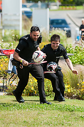 """Police chase at """"Party On The Edge"""" which was held on the Avant homes Edge development on Sunday as Special Constable Ciprian Smith (right) chases his Colleague for second place in the Egg and """"spoon race""""   with badminton rackets and footballs<br />  10 July 2016<br />  Copyright Paul David Drabble<br />  www.pauldaviddrabble.photoshelter.comom"""