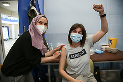 © Licensed to London News Pictures. 01/05/2021. London, UK. A woman gestures after receiving her Oxford/AstraZeneca Covid-19 vaccine at a vaccination centre in Haringey, north London. In the UK, over 34.2 million people have received a first dose and almost 14.5 million are fully vaccinated. People aged 40and over can now book their appointments through the national booking website as part of the next phase of the government's vaccination programme. <br /> <br /> ***Permission Granted*** <br /> <br /> Photo credit: Dinendra Haria/LNP