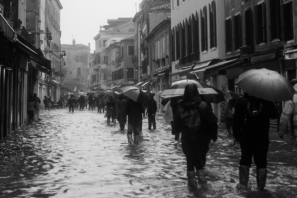 Venice, Italy. 29 October, 2018. People walk through a fooded Strada Nova during the high tide on October 29, 2018, in Venice, Italy. This is a selection of pictures of different areas of Venice that the press has not covered, were resident live and every year they have to struggle with the high tide. Due to the exceptional level of the 'acqua alta' or 'High Tide' that reached 156 cm today, Venetian schools and hospitals were closed by the authorities, and citizens were advised against leaving their homes. This level of High Tide has been reached in 1979. © Simone Padovani / Awakening / Alamy Live News