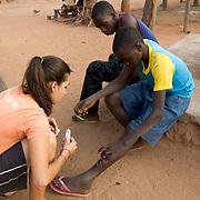 Peace Corps volunteer Rachael teaches the proper way to dress a wound. Koumbadiouma, Kolda, Senegal.