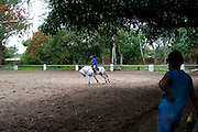 The equestrian centre of Maputo was born in the 1950 during the Portuguese Colonial time. Considered for years one of the most important place of the sub- Saharan Africa for the dressage it resisted to the colonial war and to the Mozambique civil war, his decadence started after the civil war when a poisoned batch of horse food killed most of the animal. Today the centre is trying to resume his old glory living between the past and an uncertain future. Mr Silva (riding the horse) shows to a student how to control the animal.