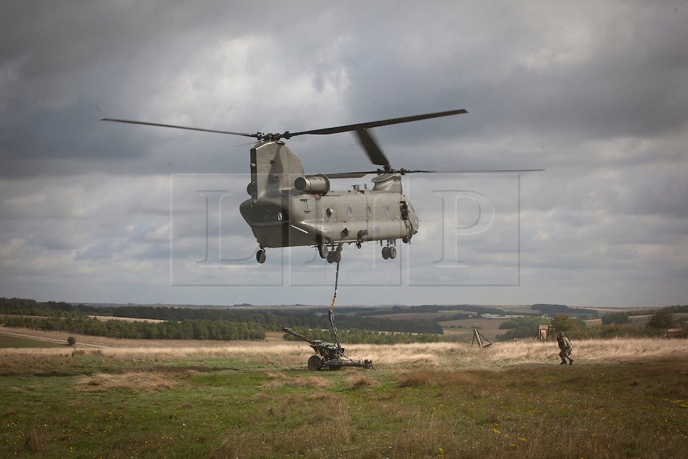 © Licensed to London News Pictures. 29/08/2013. Salisbury, Wiltshire.  Members of 7th Armoured Brigade put on a display today for National and regional media on Salisbury Plains as they make final preparations for their tour in Afghanistan.  The soldiers are set to deploy on what could be the final tour in October 2013.  The displays included a new Mark 4 Chinook helicopter, which is now assisting in the dismantling of patrol bases across Helmand Province.     Photo credit: Alison Baskerville/LNP