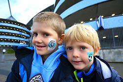 Young Manchester City fans Jack and Darragh Kineavy have their faces painted ahead of the match