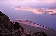 Graciosa island, Lanzarote, Canary Islands, Spain Rio in 1979 viewed from Mirador del Rio, salt evaporation pans of Salinas del Rio on land below