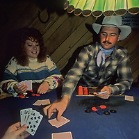 A dealer passes out cards for a legal poker game in Chet's Bar at Big Sky resort in Montana.