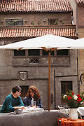A couple at an outdoor café in Segovia, Spain.